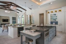 modern vaulted ceiling kitchen living room design with white and