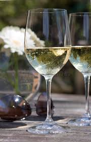 White Glass Patio Table White Wine Glass On Patio Table Aviators Flower Stock Image