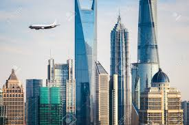 the modern buildings with airplane in shanghai china stock photo