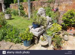 large garden ornaments including statues and pots in an