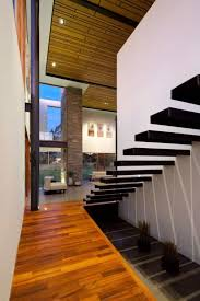 modern house with high ceiling and black floating staircase