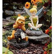 disney statue with solar lantern eeyore winnie the pooh and