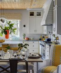 white and yellow dining chair cottage kitchen