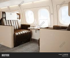 photo interior of luxury private jet empty leather chair modern