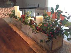 Wooden Centerpiece Boxes by Simple Wood Box With Candles And Mistletoe For A Table Piece