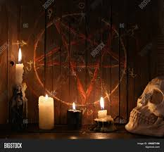 halloween photography background evil candles and scary skull against wooden background with bloody