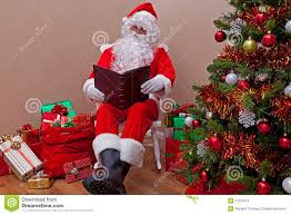 santa claus reading the list stock photos image 27203713