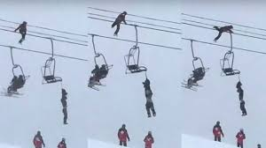 as unconscious skier hangs by neck from chairlift one guy with