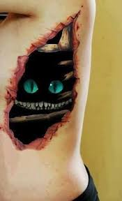 rip tattoo fail awesome cheshire cat skin rip tattoo on ribs tattoos pinterest