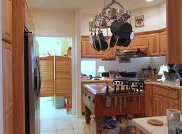 alder wood autumn madison door kitchen island with pot rack