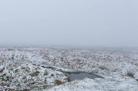 winter snow arrives in the uk in the pennines evening