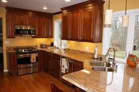 cream kitchen wall paint with brown wooden kitchen cabinet having