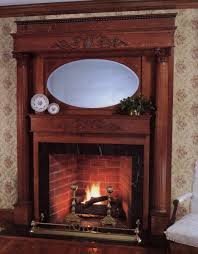 traditional stone fireplace with espresso wooden mantel shelf