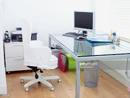 tidy modern office with desk chair computer printer and stationery