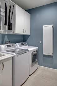 brown and blue laundry room this laundry room features warm wood