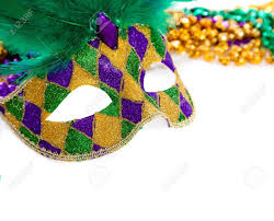 white mardi gras mask a purple gold and green mardi gras mask and on white stock