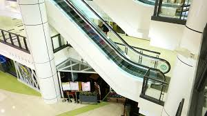 mall escalators side view large atrium space white design