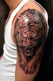 grey ink walking tiger on left shoulder