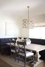 chic breakfast nook features a l shaped black tufted banquette