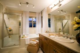 bathroom finishing ideas bathroom wood cabinets with large wall mirror plus track light