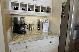 grey kitchen cabinets with granite countertops light grey wall painting black and white granite countertop