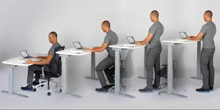 practice proper sitting and standing posture