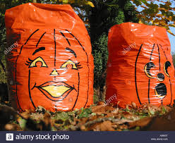 plastic halloween bags pumpkin plastic bag figures full with leaves fall autumn colors