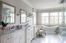 white and gray bathroom with vintage bathtub transitional bathroom