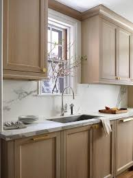 brown stained kitchen cabinets gold brown stained kitchen cabinets with brass knobs