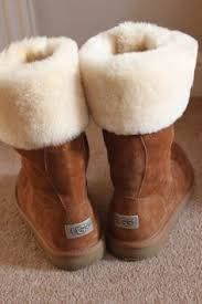 womens boots like uggs fuzzy pom pom boots for winter in black and blue fuzzy