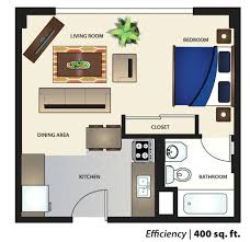 the kitchen and living area of a 530 square foot apartment at