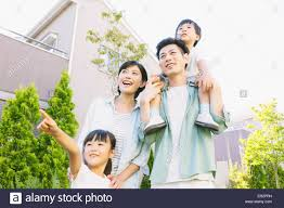 japanese family in a city park stock photo 83040373 alamy