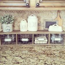 how to decorate a rustic kitchen counter organizer with metal basket storage drawers