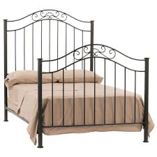 black iron bed frame with bars and curving top on the head and
