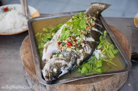 fish cuisine food steamed fish in spicy lemon soup