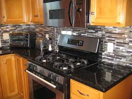 granite countertop galley kitchen cabinets clear glass mosaic