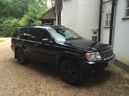 jeep grand cherokee all black jeep grand cherokee wj 4 7 ho lpg jeep club