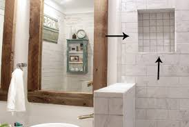 a bathroom shower with marble tile
