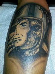 attractive oakland raiders skull tattoo