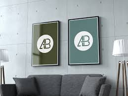 a living room wall showing two poster frames psd file with two