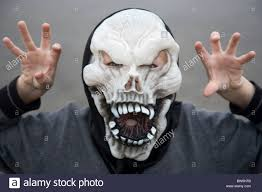 Boys Skeleton Halloween Costume Young Boy Wearing Skeleton Halloween Mask With Scary Pose Stock