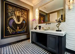 luxurious of bathroom with marble sink under long mirror near wall
