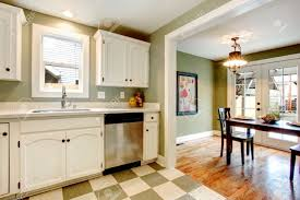 white kitchen cabinets blends perfectly with light olive walls