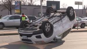 car wheel rolling on asphalt after accident crash junkyard stock