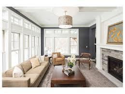 grey carpet flooring white painted beams dark wood coffee table