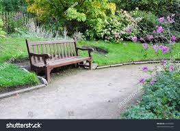 peaceful garden scene gravel walkway wooden stock photo 65335822
