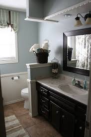 blue gray walls and espresso cabinets love the wall for more