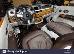 roll royce inside interior steering wheel and luxury wooden panel inside a rolls