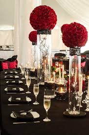 Wedding Centerpieces With Crystals by Deep Red Rose Balls On Cylinder Vases With Hanging Crystals And