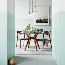 dining room with half painted walls pale mint green and white